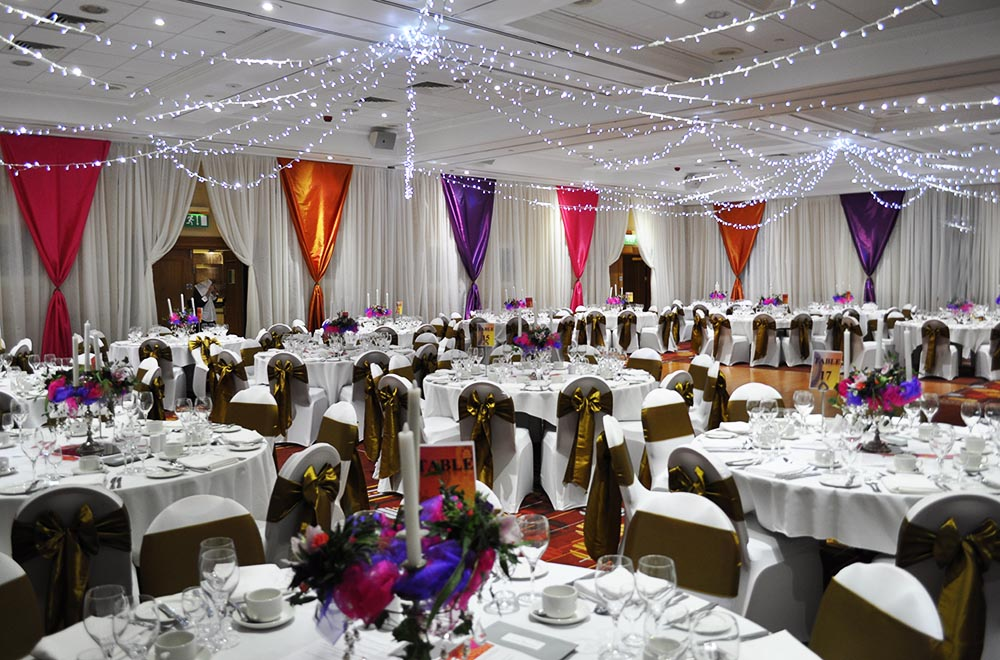 Coloured wall drape overlays at Swindon Marriott with fairy lights