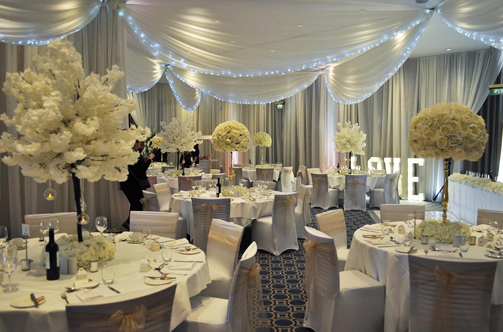 Wall and Ceiling drapes with white fairy lights, Uplighting and illuminated LOVE letters for a wedding breakfast at Alexandra House Conference centre Swindon