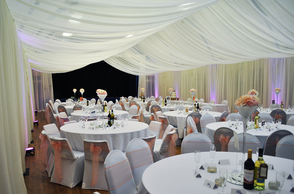 Full room indoor marquee style ceiling and wall drapes at Cricklade Town Hall