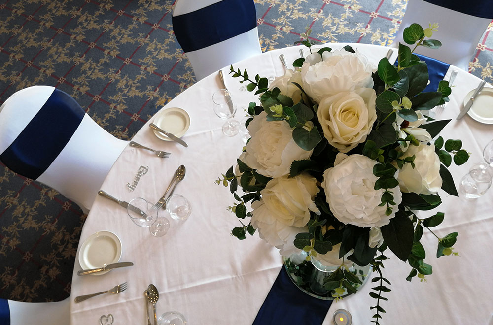 Wedding Breakfast table set up at the Wrag barn Golf Club in Highworth, Swindon. With large table centrepiece